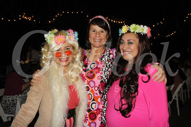 Raffle co-chairs Alice Perez, Tracey Nelson and Trish McRae