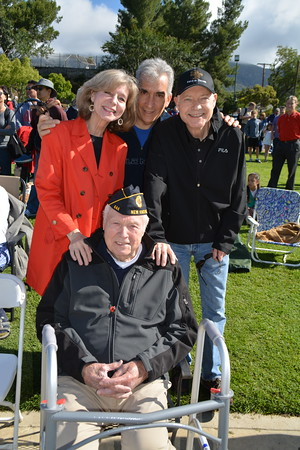 seated Veteran Cal Elshoff, with Cindy and Anthony Lupica and Fr  Matt Elshoff 823