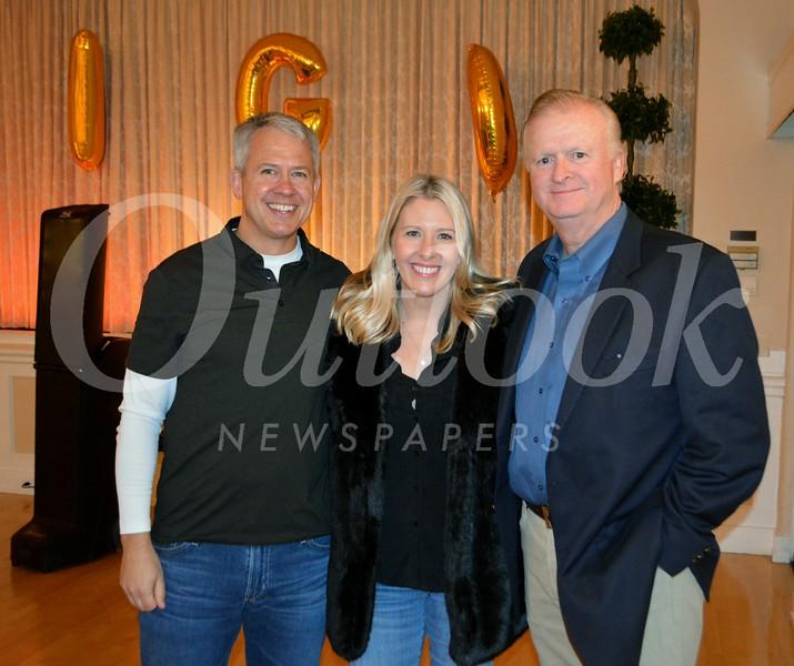 Boosters President Jeremy Milbrodt, event chair Justine Plocher and Bingo caller John Cervenka