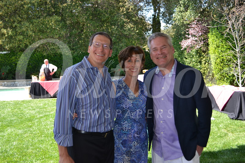 Hosts Dave and Julie Battaglia with Keith Hobbs