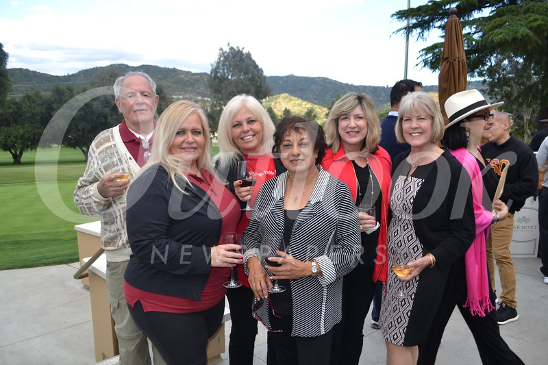 Angela Mandujano (front row, from left) and Hassie Ramnath. Back: Ken Rendler, Maria Fuentes, Becky Happach and Ruth McNevin.