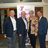 YMCA Chairman of the Board Brian Daniels, honoree Dennis and his wife, Peggy Croxen, and President/CEO Tyler Wright.