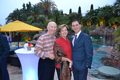 Bill and Laura Olhasso with YMCA CEO Tyler Wright