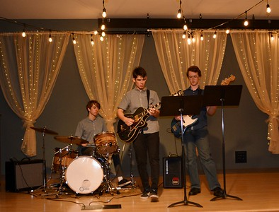 High schoolers Zach Northrop, Iman Beshia and Liam Crehan  performed during dinner and dessert  475