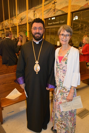 The Rev  Torkom Donoyan from the Armenian Apostolic Church and Christie Frandsen of the Baccalaureate Committee 562