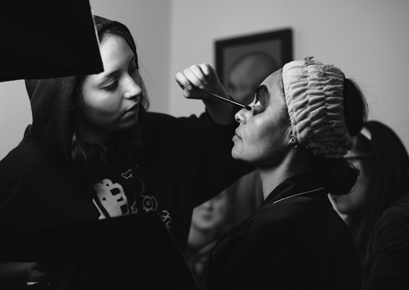 Natalia Wallace behind the scenes working on make up for the Catrina shoot.