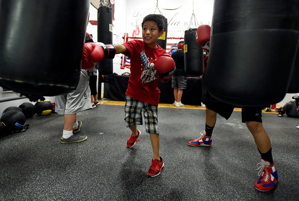 . Paul Guevara, 8, works out on a heavy bag during an after-school boxing class for kids on Thursday at La Familia Boxing inside the YMCA in Longmont. For more photos and video of the after-school boxing program go to www.timescall.com Jeremy Papasso/ Staff Photographer/ May 11, 2017