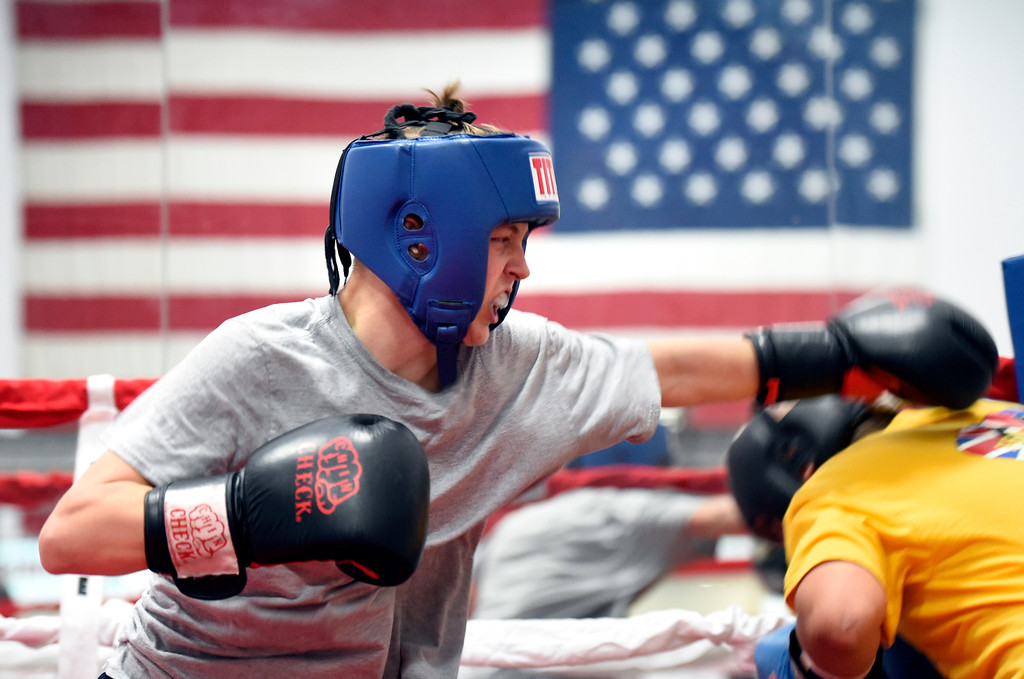 . Shawn Mears, 16, at left, throws a punch at Damian Campos, 12, while sparring during an after-school boxing class for kids on Thursday at La Familia Boxing inside the YMCA in Longmont. For more photos and video of the after-school boxing program go to www.timescall.com Jeremy Papasso/ Staff Photographer/ May 11, 2017