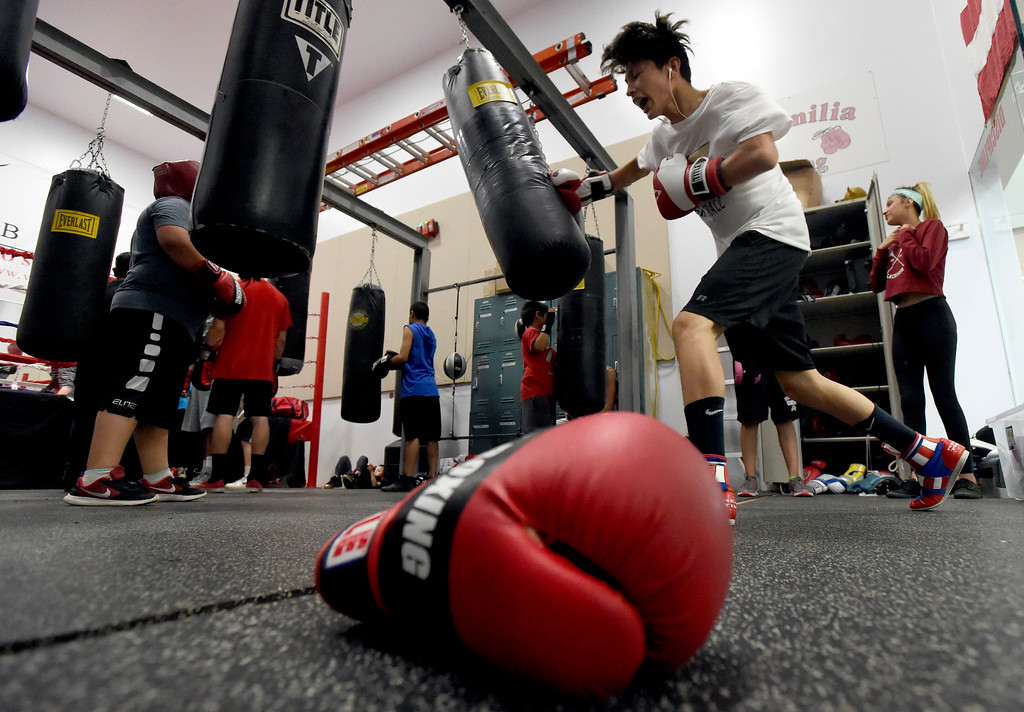 . Jose Campos, 15, punches a heavy bag while working out during an after-school boxing class for kids on Thursday at La Familia Boxing inside the YMCA in Longmont. For more photos and video of the after-school boxing program go to www.timescall.com Jeremy Papasso/ Staff Photographer/ May 11, 2017