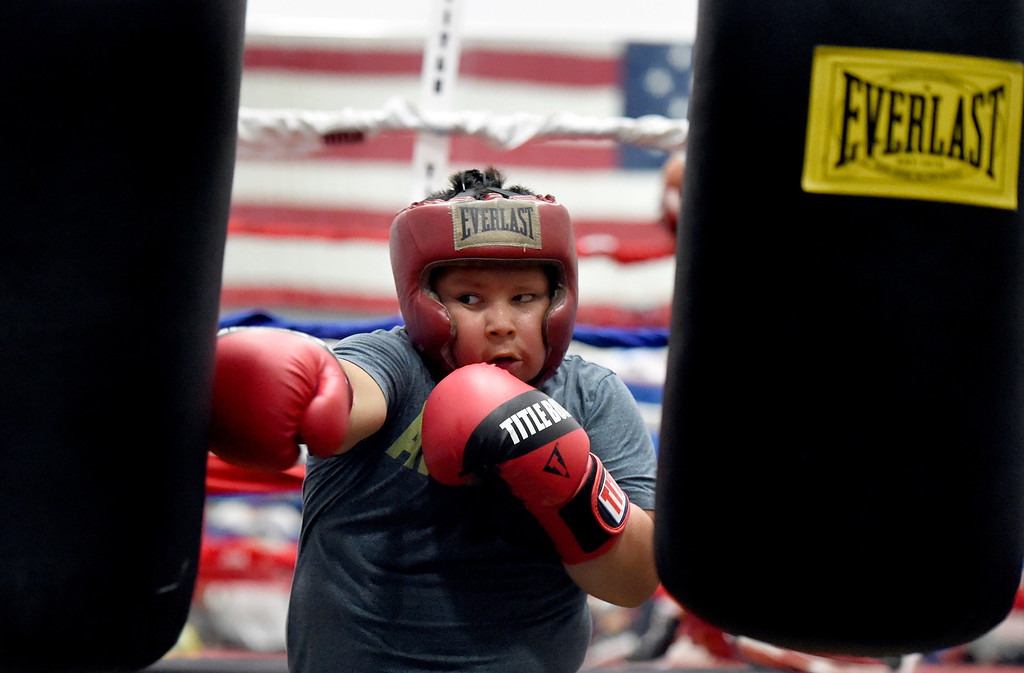 . Joel Cano, 10, punches a heavy bag while working out during an after-school boxing class for kids on Thursday at La Familia Boxing inside the YMCA in Longmont. For more photos and video of the after-school boxing program go to www.timescall.com Jeremy Papasso/ Staff Photographer/ May 11, 2017