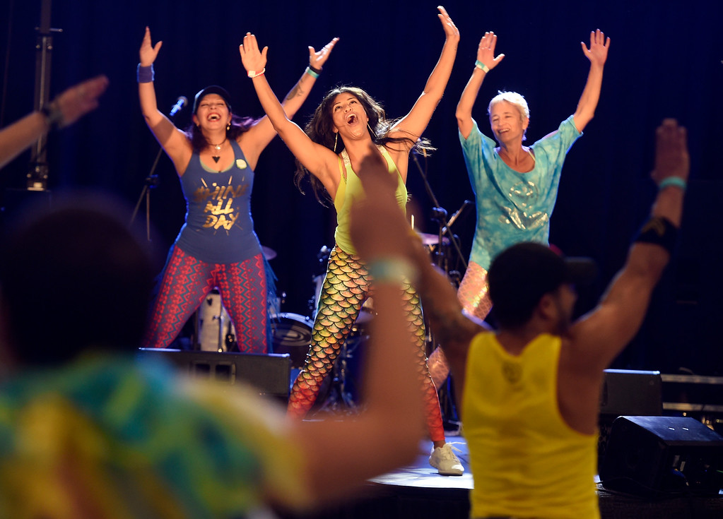 . LONGMONT, CO: September 8:  Karina Xaubet, left, Stephanie Alvarez, and Dawn Emming, lead a Zumba dance party during the La Fiesta Underwater World Party that benefits Intercambio held  at the Boulder County Fairgrounds in Longmont on Saturday. (photo by Cliff Grassmick/Staff Photographer).