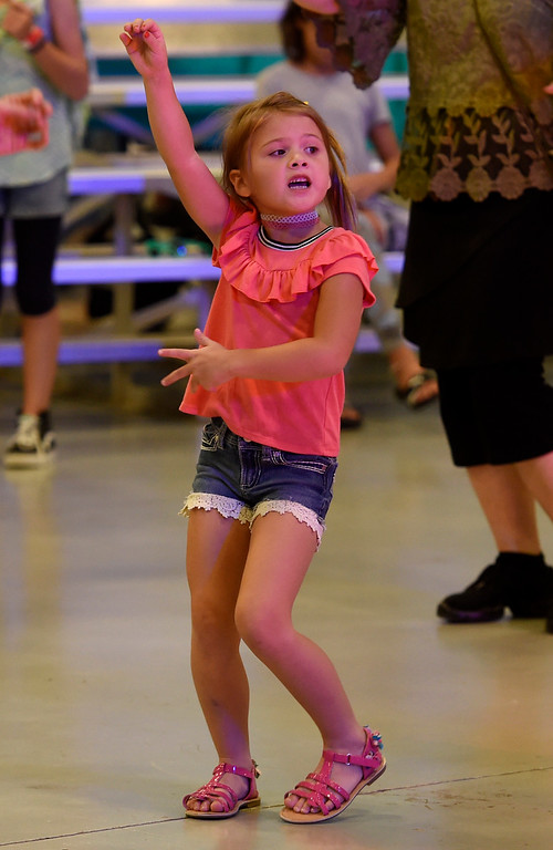 . LONGMONT, CO: September 8:  Mila Su Castillo, 6, dances to Zumba during the La Fiesta Underwater World Party that benefits Intercambio held  at the Boulder County Fairgrounds in Longmont on Saturday. (photo by Cliff Grassmick/Staff Photographer).