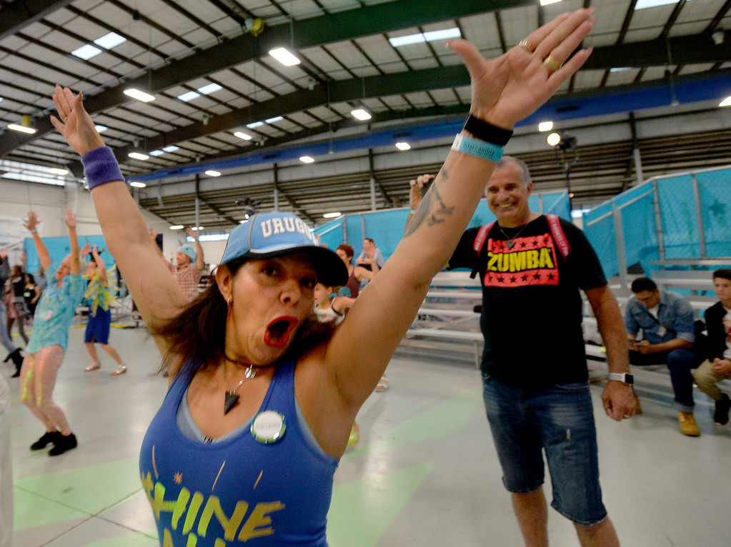 . LONGMONT, CO: September 8:  Karina Xaubet dances to Zumba music during the La Fiesta Underwater World Party that benefits Intercambio held  at the Boulder County Fairgrounds in Longmont on Saturday. (photo by Cliff Grassmick/Staff Photographer).