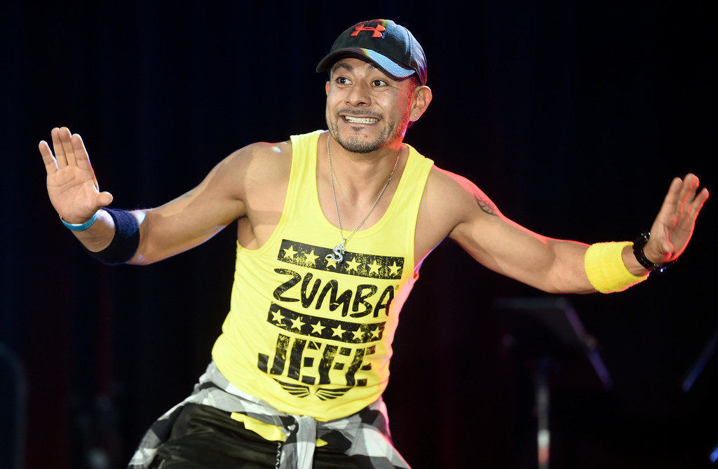 . LONGMONT, CO: September 8:  Jose Jimenez goes to the stage to lead Zumba during the La Fiesta Underwater World Party that benefits Intercambio held  at the Boulder County Fairgrounds in Longmont on Saturday. (photo by Cliff Grassmick/Staff Photographer).