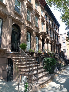 The aforesaid block of brownstone houses.