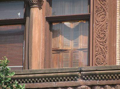 Detail of same, showing interior wooden shutters drawn to repel the summer sun.