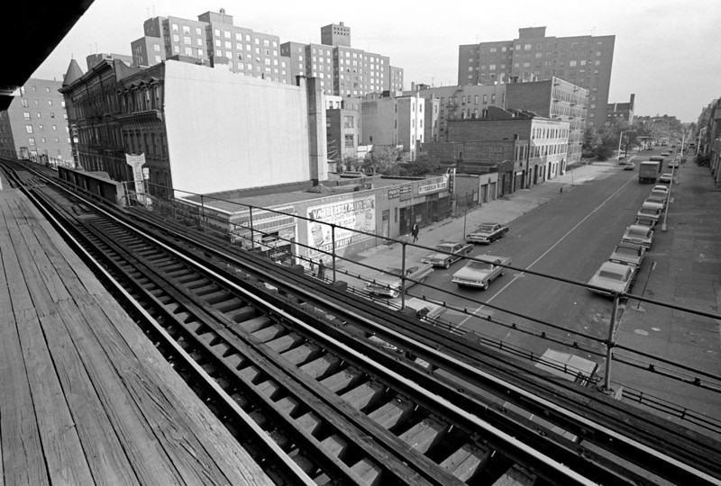 Vanderbilt Avenue looking south from the Vanderbilt Avenue station of the Myrtle Avenue El.  Taken with a Nikon FTn, 21mm f/4.5 Nikon lens.  The lens is a shtarker!  It has great contrast and sharpness, very even illumination across the frame, and beautiful rectilinearity.  The rear element of the lens is only 1 cm from the film plane; yet the illumination is very even from corner to corner!  (This shot dates to the late 60's.)