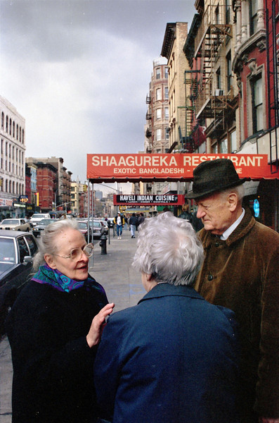 Prior to joining the card party, Mrs. Cullinan, left, Mrs. Ann Hearn, and Bro. Andrew Hayes converse on Second Avenue.  Sixth Street lies uptown in the background.
