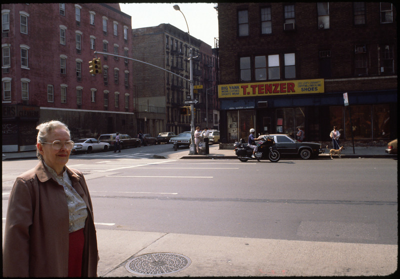 Mom (Mrs. Cullinan) on First Avenue and Third Street, on her way to the card party.   There used to be a Fat Man's Store on the corner there.