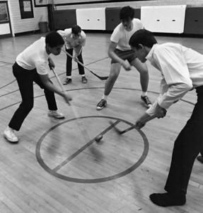 #51. October -- Intramural hockey. Varsity group shots.