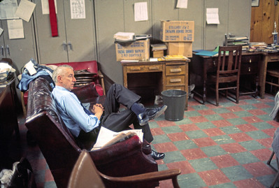 "Mr. Mack in the faculty lounge in the basement.  Us teachers used to call it ""the Pit.""  It was ""below level,"" meaning subterranean."