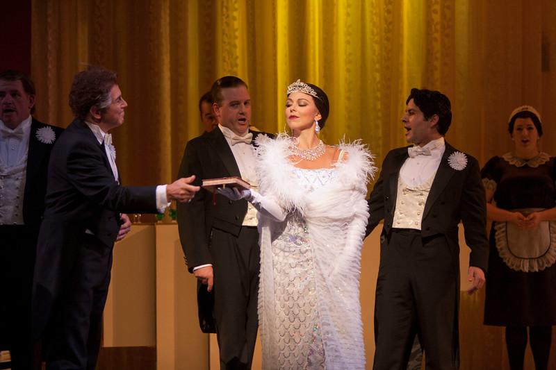 Soprano Corinne Winters is Violetta Valéry, flanked by the San Diego Opera Chorus, in San Diego Opera's LA TRAVIATA. April, 2017. Photo by J. Katarzyna Woronowicz Johnson.