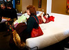 HOLLY PELCZYNSKI - BENNINGTON BANNER Christine Seward, and Monica Dattilo of Williston, take a break on a mattress waiting to place their bid during the LaFlammes bankruptcy auction held on Saturday in Bennington.