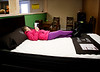 HOLLY PELCZYNSKI - BENNINGTON BANNER Francesca Lynch, 8 years old of Bennington lays on a mattress and reads a book while waiting for her mom during the bidding at LaFlammes bankruptcy auction held on Saturday in Bennington.