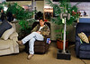 HOLLY PELCZYNSKI - BENNINGTON BANNER John Zak, of Sandgate, gets some rest on a recliner during LaFlammes bankruptcy auction held on Saturday in Bennington.