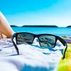 Sunglasses on a beach towel.
