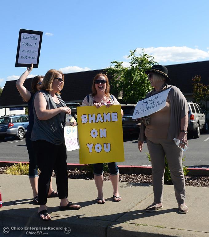 . Protestors wave signs and chant Friday, May 12, 2017, outside U.S. Representative Doug LaMalfa\'s office in Oroville, California. (Dan Reidel -- Enterprise-Record)