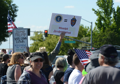 Protestors wave signs and chant Friday, May 12, 2017, outside U.S. Representative Doug LaMalfa's office in Oroville, California. (Dan Reidel -- Enterprise-Record)