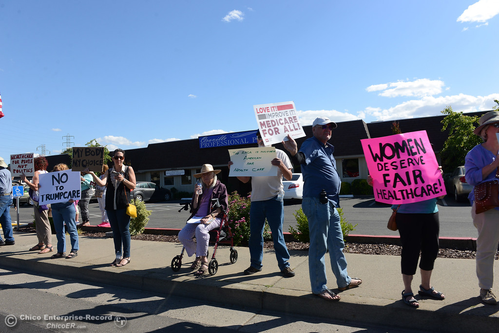 . Protestors wave signs and chant Friday, May 12, 2017, outside U.S. Representative Doug LaMalfa\'s office in Oroville, California. (Dan Reidel -- Enterprise-Record)