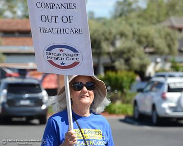Protestors wave signs and chant Friday, May 12, 2017, outside U.S. Representative Doug LaMalfa's office in Oroville, California. (Dan Reidel -- Enterprise-Record)