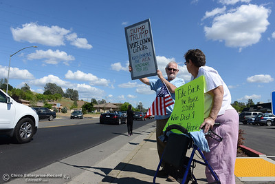 Donald and Judy Whitehead, of Oroville, join protestors to wave signs and chant Friday, May 12, 2017, outside U.S. Representative Doug LaMalfa's office in Oroville, California. (Dan Reidel -- Enterprise-Record)