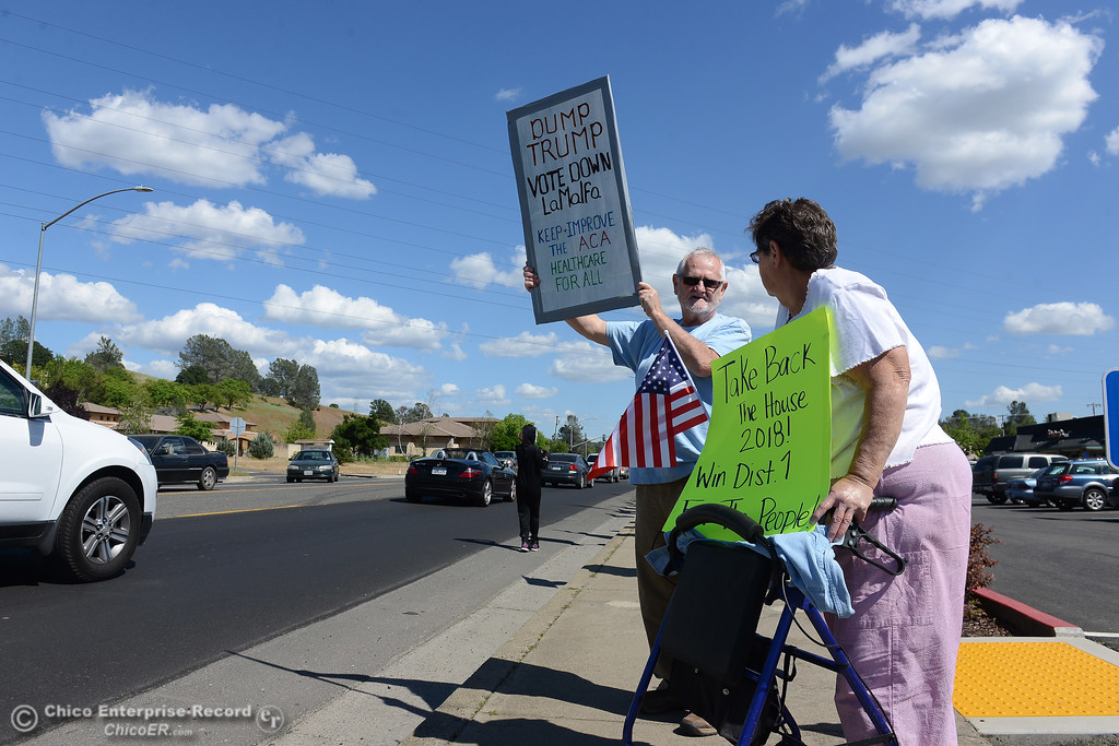 . Donald and Judy Whitehead, of Oroville, join protestors to wave signs and chant Friday, May 12, 2017, outside U.S. Representative Doug LaMalfa\'s office in Oroville, California. (Dan Reidel -- Enterprise-Record)