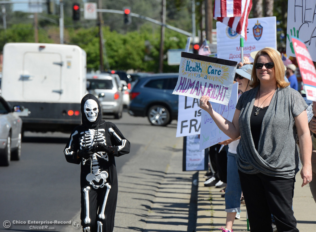 . Stephanie Leaf, left, in skeleton costume, and Mary Beth Flanagan, right, of Paradise, are among protestors Friday, May 12, 2017, outside U.S. Representative Doug LaMalfa\'s office in Oroville, California. (Dan Reidel -- Enterprise-Record)