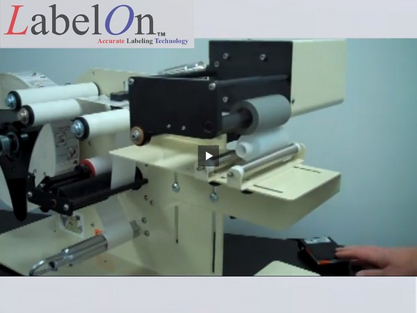 LabelOn™ Benchtop for Round Products – Roller Drive Rotation