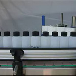 LabelOn™ Basic Round Bottle Labeling Showing Spacer Wheel