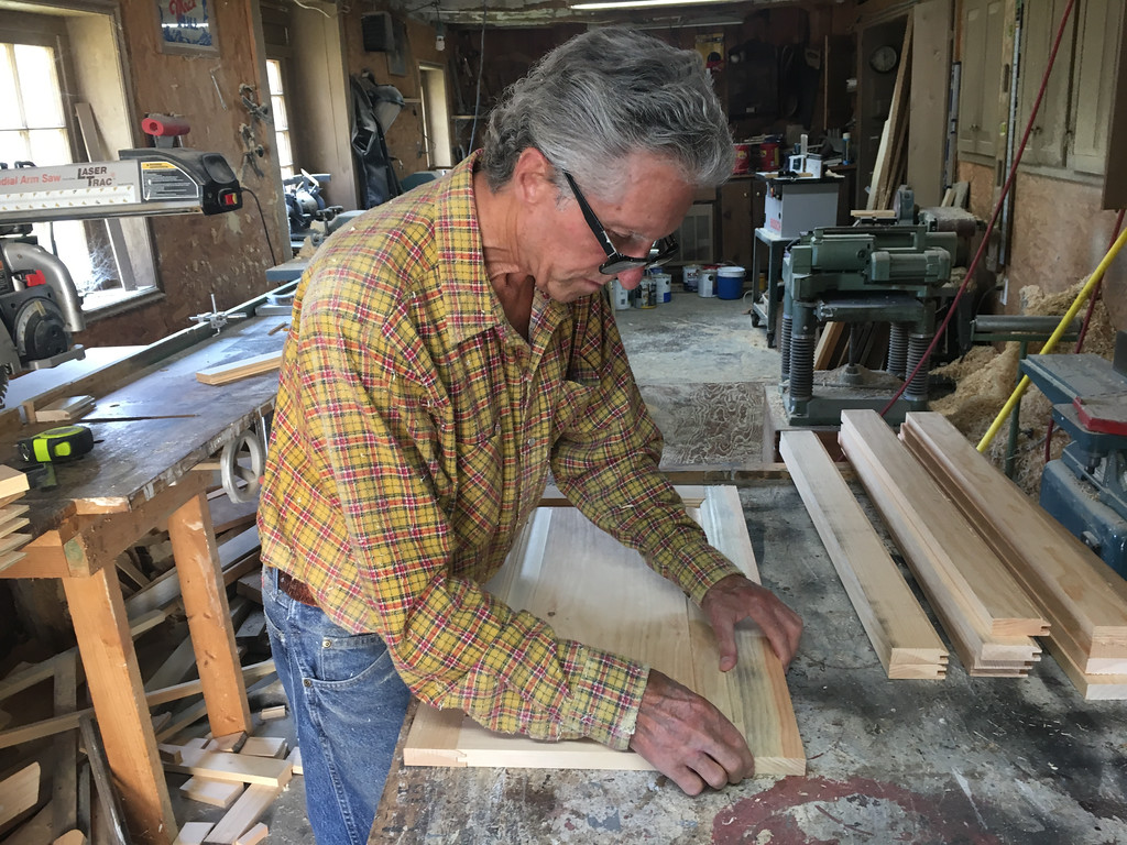 . Richard MacKay continued to assemble cabinet door fronts from the wooden sections he made in is Billerica workshop. Photo by Mary Leach