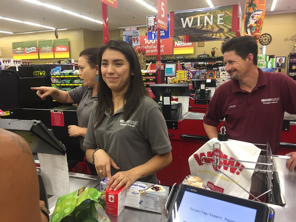 . HILLARY OJEDA/THE WILLITS NEWS �Working on a holiday, it�s just like any other day. I�ve been doing this for about 22 years. I celebrate my labor day anytime I get a day off,� said Aaron Evans, store manager at Grocery Outlet. To his left stand Maria Chavez and Jennifer Danner.