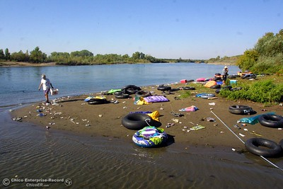 Beer can beach and area around it 8 AM tuesday morning. This is the mess left behind by tubers on labor day.  ty  news 09/03/01--In this picture--At the mouth of Pine Creek at the Sacramento River Scavengers Marlys Westphal and Pete Cardoza going through the mess
