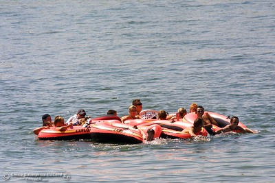 Tubers tie each other togwether as they drift in the Sacramento River. photo by Glenn Fuentes 09/02/02