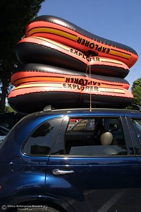 Tubes are tied to a Chrysler PT Cruiser(owned by Lyzzette Hernandez) as they get ready to head to Beer Can Beach monday in the Sacramento River. photo by Glenn Fuentes 09/02/02