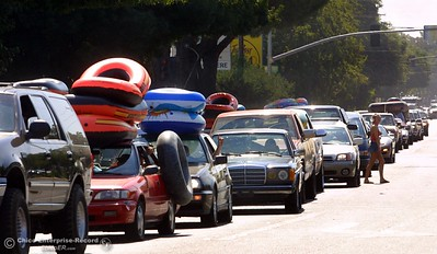 Traffic is at a stand-still at Walnut and 2nd Street as tubers head out to  Beer Can Beach Monday in the Sacramento River.  photo by Glenn Fuentes