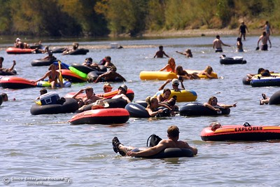 Tubers drift around Beer Can Beach Monday in the Sacramento River. photo by Glenn Fuentes 09/02/02
