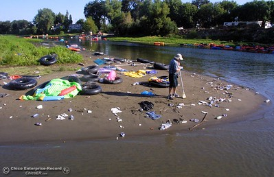 Beer can beach and area around it 8 AM tuesday morning. This is the mess left behind by tubers on labor day.  ty  news 09/03/01--In this picture--this is the mouth of Pine Creek at the Sacramento River. Pete Cardoza goes through the mess.He started scavenging at 5 AM