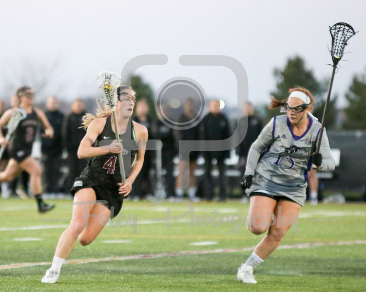 Lafayette Maggie Carver (4) Holy Cross Maddy Smith (15)