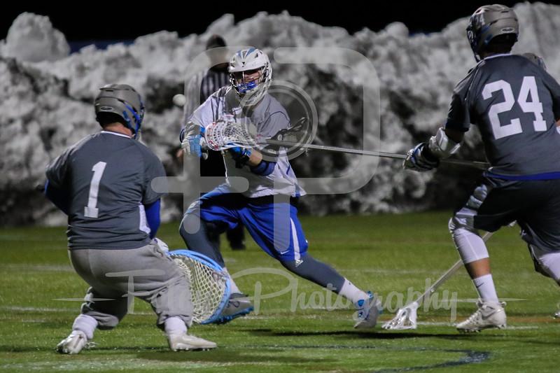 Becker College Hawks attack Blake Boutiette (15) Albertus Magnus goalie Jack Kerner (1)