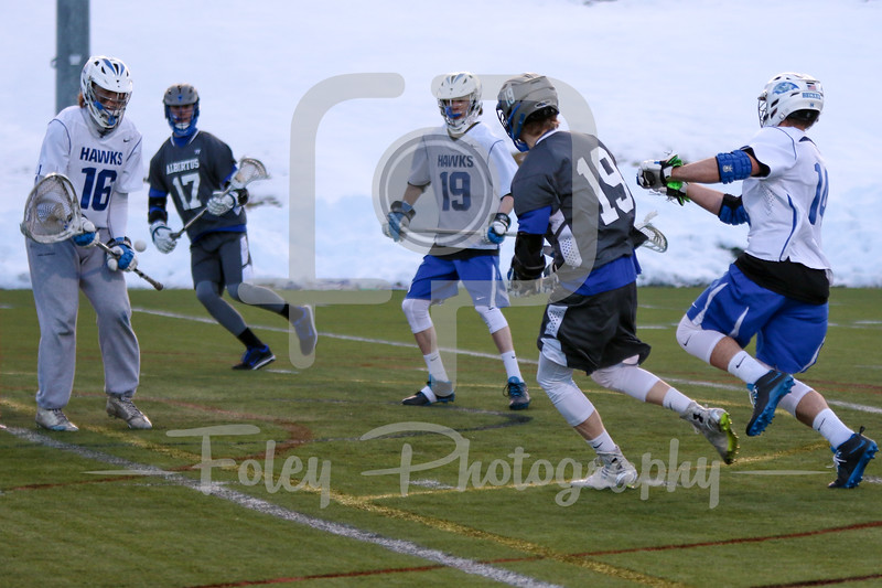 Becker College Hawks goalie Michael Krch (16) Albertus Magnus attack Brennan Moore (19)